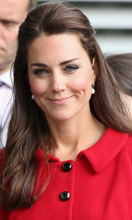 With a smile and a half-up do, the Duchess gave a professional look for some office inspiration during a visit to Christchurch in New Zealand.