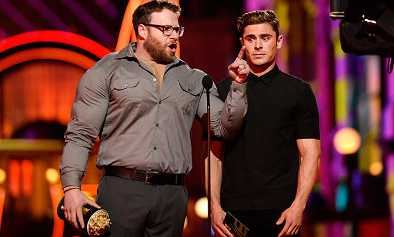 Battle of the muscles: Seth Rogan hilariously put his <i>Neighbors 2</i> co-star Zac Efron to shame with his new rock hard abs and body. 