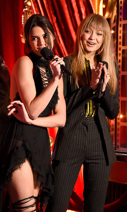 If you can't present with your best friend, who can you present with? Kendall Jenner and Gigi Hadid took to the Movie Awards stage in style to introduce performer Ariana Grande. 