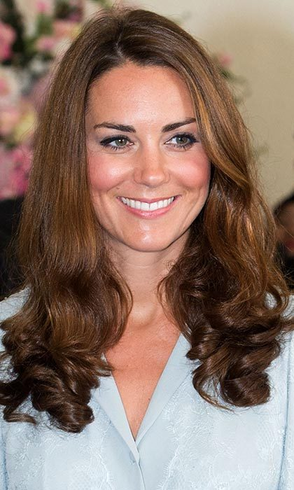 Kate showed the beauty of her natural waves in Kuala Lumpur with William.