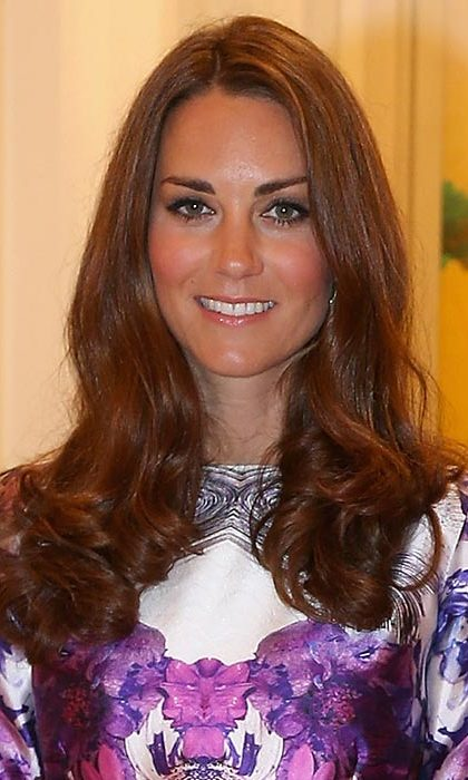 Kate was sun-kissed and radiant with her trademark blow-dry style for a dinner in Istana, Singapore.