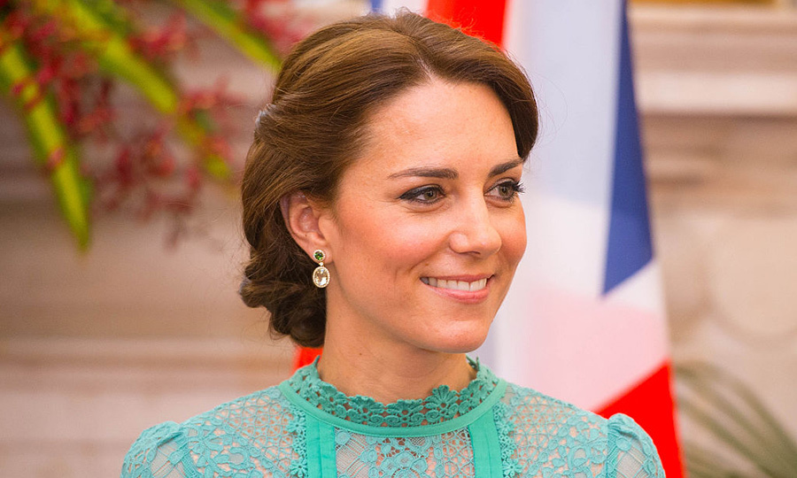 Kate swept her hair into an updo for a meeting with India's Prime Minister, giving a subtle nod to one of the season's biggest hair trends with braid details in the chignon.