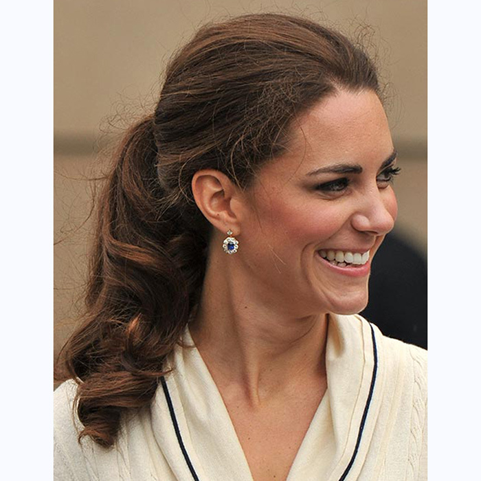 At Province House in Charlottetownm, Kate swept her hair back with a loose ponytail with volume at the crown was the style of the day. 