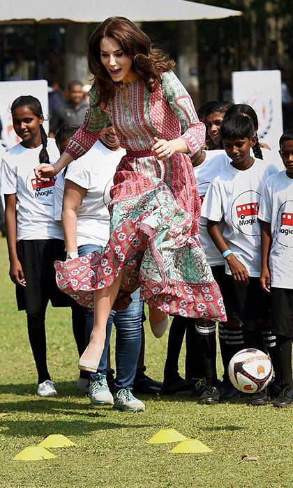 On the same visit, she hit new heights as she participated in training exercises with the kids.