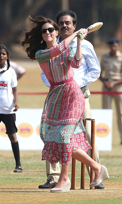 Wearing wedge heels didn't stop Kate from smacking a cricket ball at an engagement in Mumbai on the first day of her tour of India with Prince William.