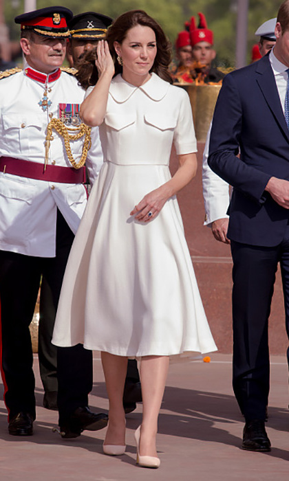 The royal beat the heat on day two while wearing a knee-length white frock by Emilia Wickstead paired with Rupert Sanderson heels. 