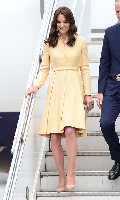 The royal tour continues in Bhutan! The 34-year-old  made her fashionable entrance in a recycled buttermilk yellow coat dress from one of her favorite designers, Emilia Wickstead.