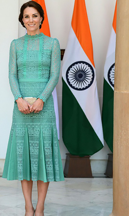 During her meeting with the Indian Prime Minister, Kate went with a lacey sea foam green Alice Temperley dress.