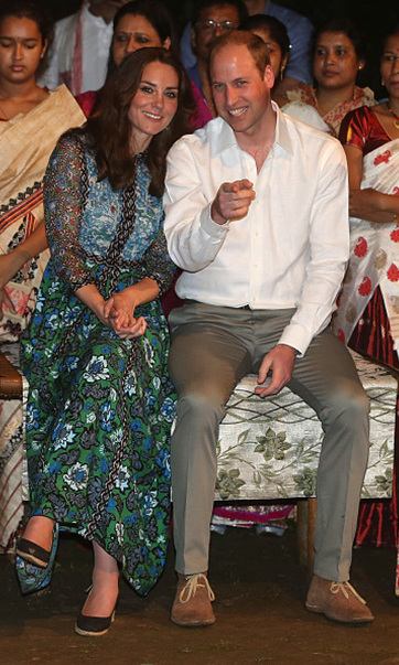 While taking in the dancing at the Bihu Festival with Prince William, Kate looked chic in a printed Anna Sui dress and Dune London wedges.