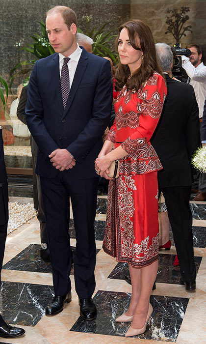 Upon her arrival to the Taj Mahal Palace Hotel, Duchess Kate went for a red patterned Alexander McQueen dress with nude L.K.Bennett heels and topped the look off with a gold Russell & Bromley clutch.