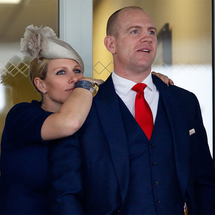 Equestrian fans Zara Phillips and husband Mike Tindall kept their eyes on the track at the Grand National horse racing competition in Gloucestershire, England.
