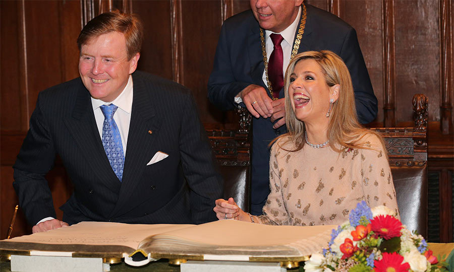 King William Alexander and Queen Maxima of the Netherlands were all smiles during their visit to Germany as they signed the golden book in the town hall in Munich.
