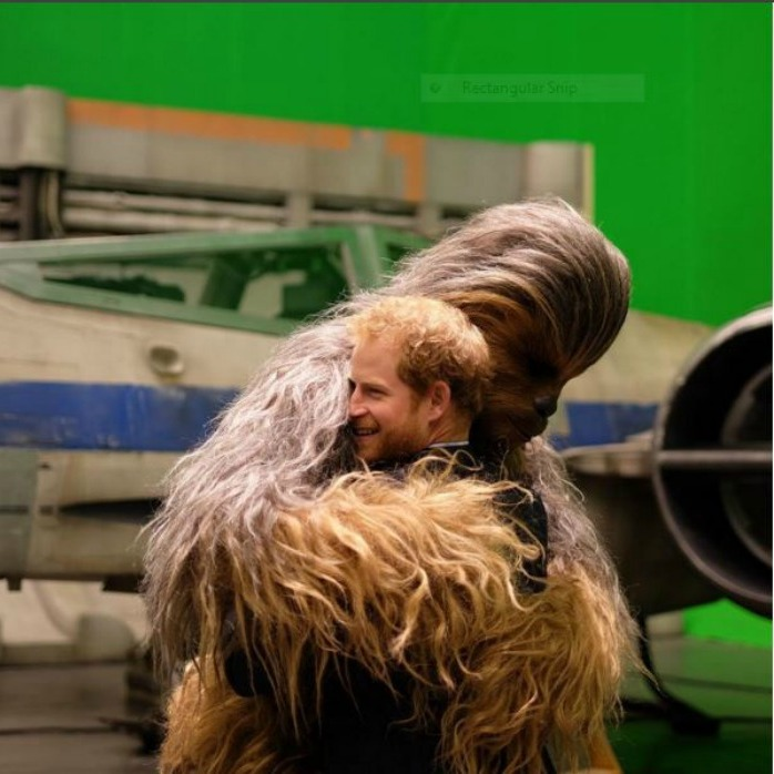 Prince Harry got a sweet embrace from <i>Star Wars</i> character Chewbacca during his visit to Pinewood Studios in London. 