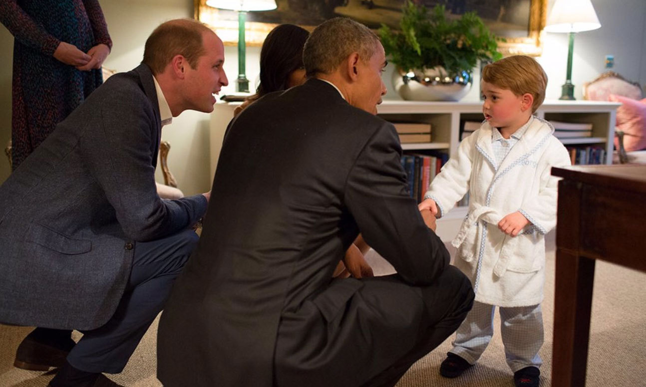 Prince George already proving to be an effective world leader in the making! The two-year-old shook hands with President Obama in his home at Kensington Palace.