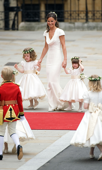 Maid-of-honor Pippa Middleton kept her eyes on the page boys and flower girls who included (from right): Eliza Lopes, daughter of William and Harry's stepsister Laura. 