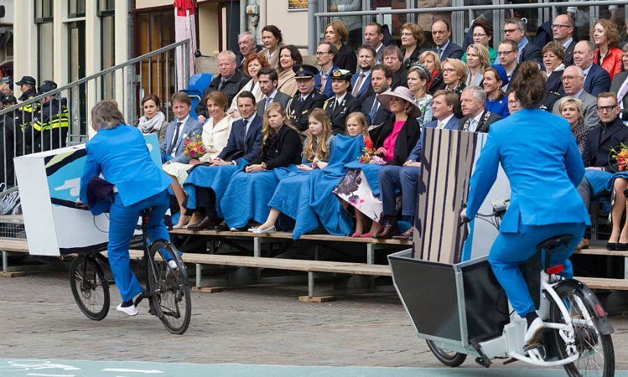 The Dutch royal family kept warm with blankets as they enjoyed a performance on King's Day.