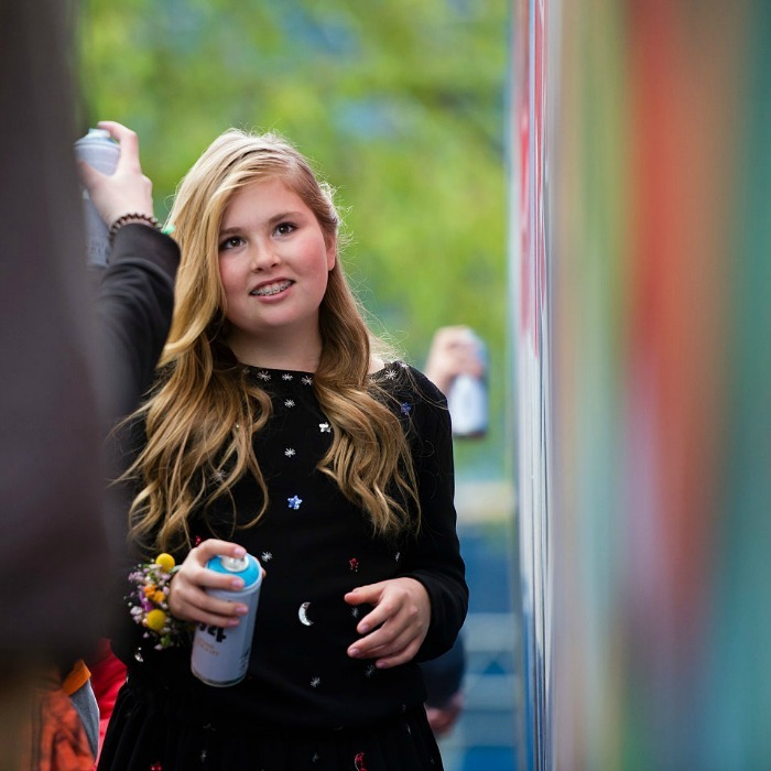 Crown Princess Catharina-Amalia sprayed graffiti on a wall as her parents, Queen Maxima and King Willem-Alexander looked on.