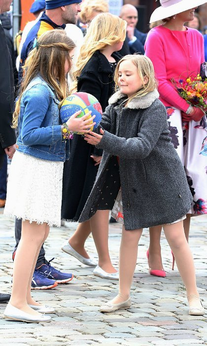 Play ball! Sisters Princess Alexia and Princess Ariane played with a basketball during their dad's birthday festivities.