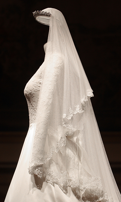 The back of Kate's dress included a folded detailing in the back made with ivory and whitesatin gazar fabric. In true McQueen style, the bodice was narrowed at the waist with padding on the hips. 