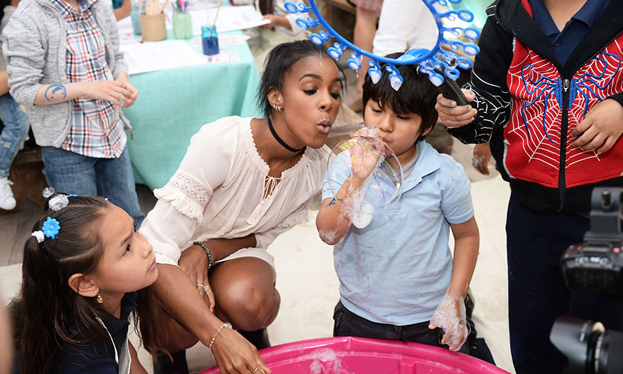 April 27: Kelly Rowland blew some bubbles and had a good time at the Baby2Baby & Tiny Prints Mother's Day Playdate at Au Fudge in West Hollywood. 