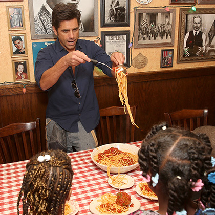 April 27: Hot cooking! John Stamos hosted a lunch for 15 children at Buca di Beppo at the Universal City Walk for the non-profit organization, Childhelp.