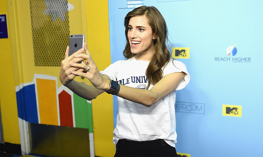 April 26: Rep your college! Allison Williams had some selfie fun during the College Signing Day at the Harlem Armory in NYC with Michelle Obama. 