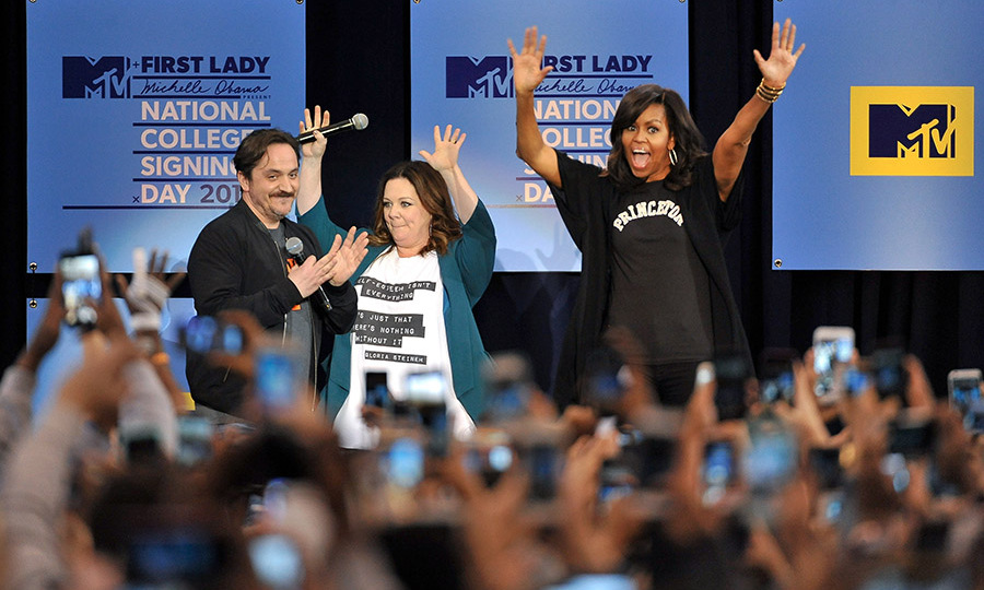 April 26: Best years of your life! First Lady Michelle Obama, Melissa McCarthy and Ben Falcone celebrated with students at the College Signing Day at the Harlem Armory in NYC. 