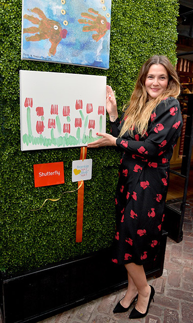 April 25: Picture this! Drew Barrymore showed off her girls' art work at the Shutterfly Mother's Day event in partnership with Children's Hospital Los Angeles in West Hollywood. 