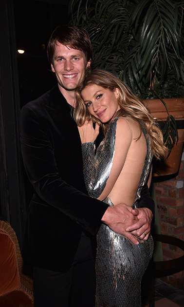 April 30: Date night! Gisele Bündchen, who wore Julien Macdonald, posed with her husband Tom Brady during her Spring Fling Book Launch sponsored by Fiji Water and elit Vodka in NYC. 