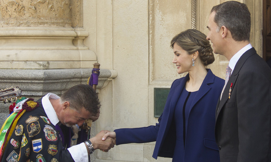 Queen Letizia of Spain looked chic in a navy blue suit as she attended the attended the Cervantes Prize award ceremony at the University of Alcala de Henares alongside her husband King Felipe.