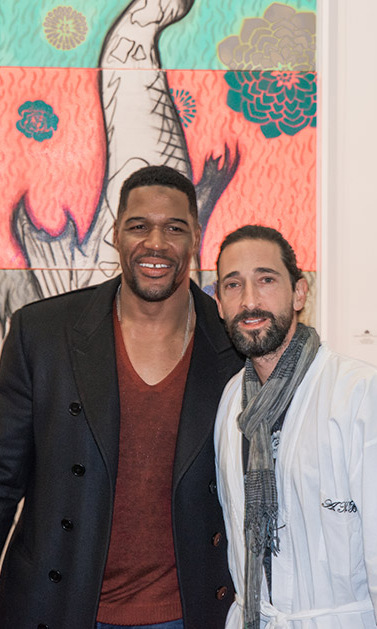 "May 3: Adrien Brody showed off his exhibit ""Hooked"" to Michael Strahan during the VIP Preview of Art New York and CONTEXT New York.