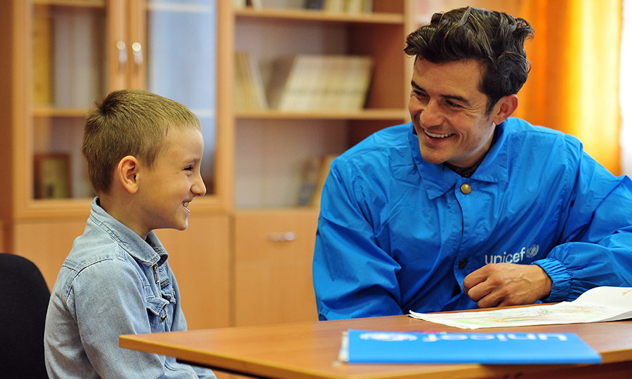 April 28: For the children! UNICEF Goodwill Ambassador Orlando Bloom spoke to a young student during his visit to Myronivskyi in the Ukraine.