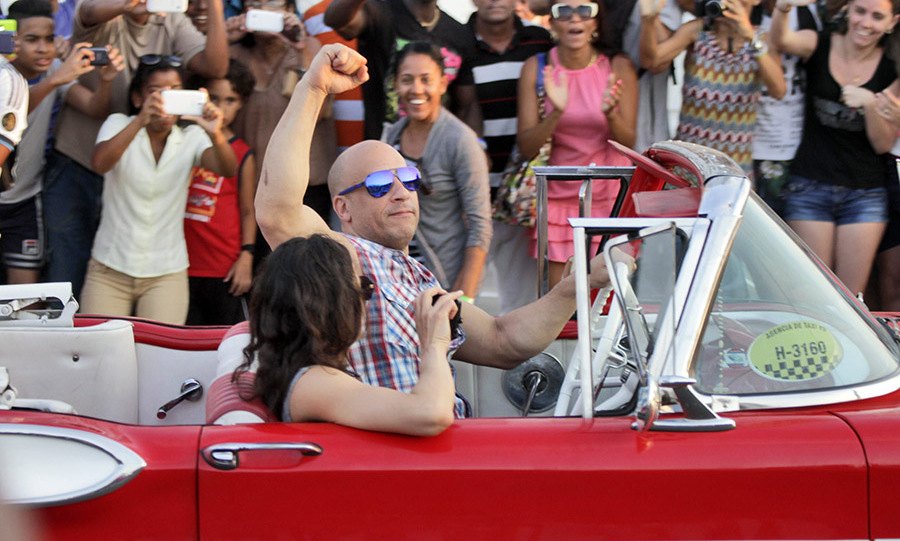 April 28: Too fast in Cuba! Vin Diesel and Michelle Rodriguez rode through Havana, Cuba at the end of their filming day for <i>Fast and Furious 8</i>