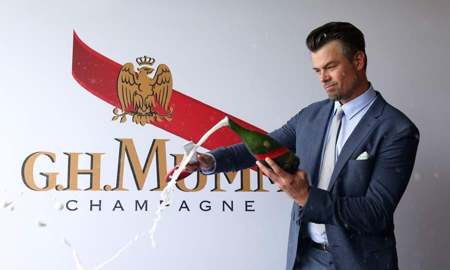 May 7: Popping bottles! Josh Duhamel looked dapper when he attended the 142nd Annual Kentucky Derby and enjoyed the perks of being a guest in the G.H. Mumm Champagne tent.
