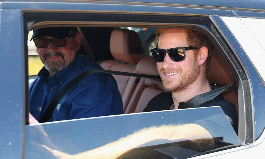 Cheeky Harry flashed his trademark grin for the cameras as he attended the Jaguar Land-Rover Driving Challenge. 