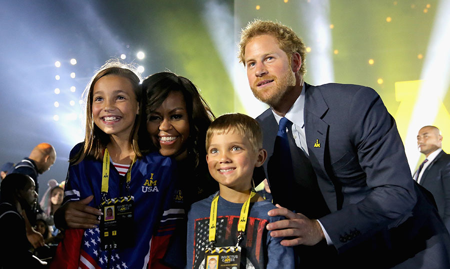 Harry and his friends were photobombed by Michelle Obama while taking a picture at the opening ceremony. 