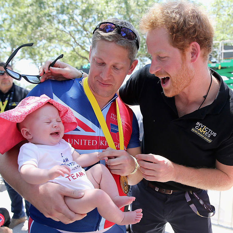 It's Prince Harry, baby! The royal was excited to meet Pippa and her father, double British gold winner Rob Cromey-Hawke at the road cycling event.