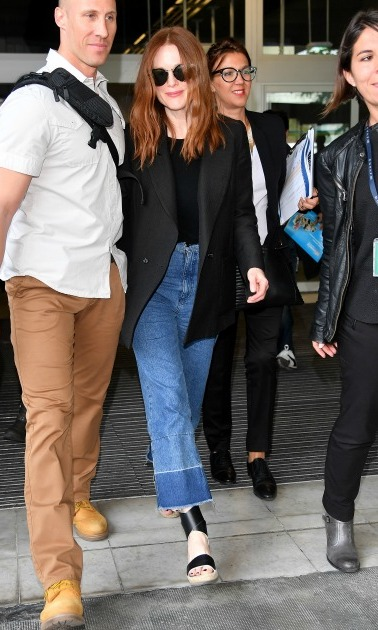 May 10: Julianne Moore added some flair to her denim and blazer ensemble before the premiere of her film <i>Wunderstruck</i>.