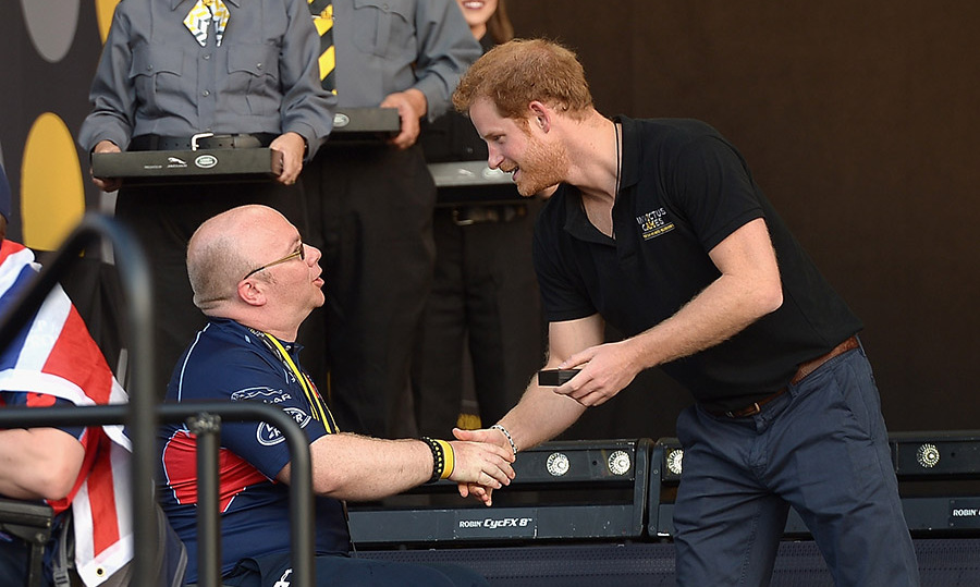 Harry shook the hand of a competitor during the final day of the 2016 Invictus Games. 