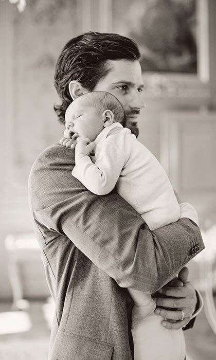 The official portraits were released to celebrate Carl Philip's 37th birthday. In of one the pictures, he can be seen adorably holding the young boy as he sleeps on his father's shoulder.