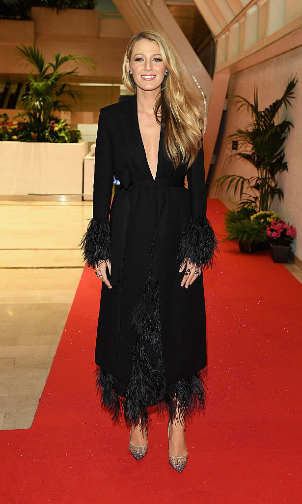 Blake Lively changed into a plunging, feathered Salvatore Ferragamo coat over her Preen by Thorton Bregazzi dress to attend the festival's opening night gala dinner.