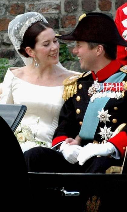 The look of love. The newlyweds could hardly take their eyes of each other as they were taken in an open carriage, accompanied by outriders and an escort of the Royal Danish Guard Hussar Regiment, to their wedding reception.