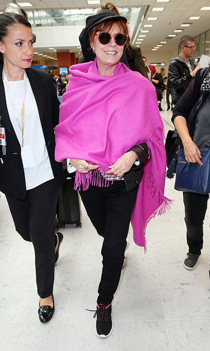 May 14: Susan Sarandon added a splash of color to Nice airport when she arrived wearing a eye-catching magenta shawl.