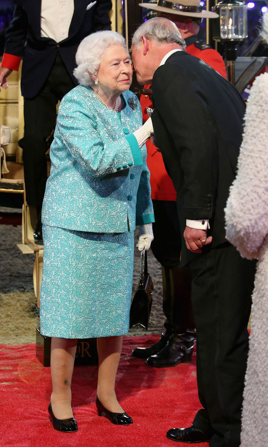 The Queen greeted her son Prince Charles with a kiss upon arrival. The monarch opted to wear a sea green dress with lace overlay and matching jacket by Angela Kelly.