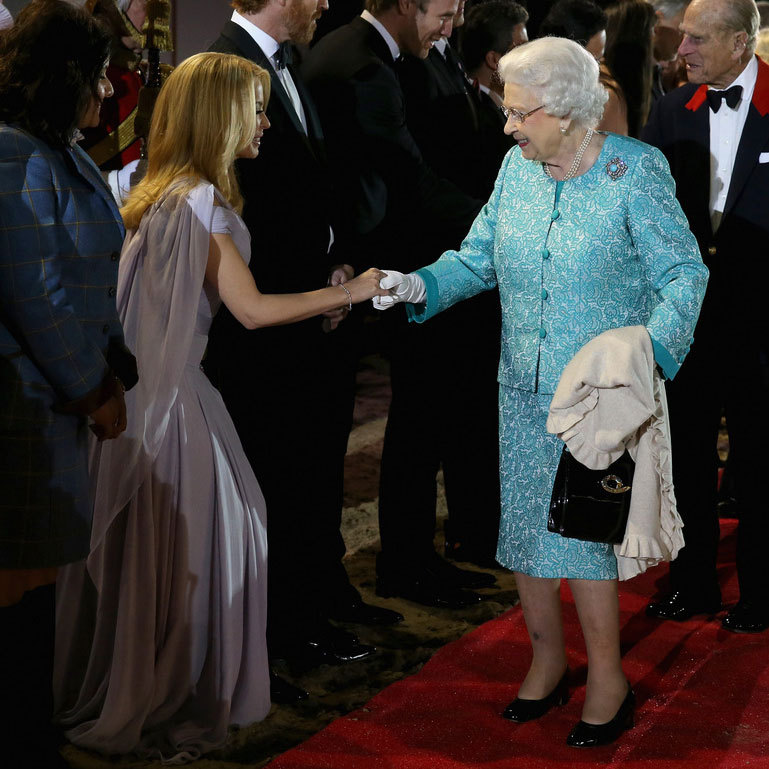 Queen Elizabeth greeted one of the evening's celebrity performers, Kylie Minogue, at Windsor.