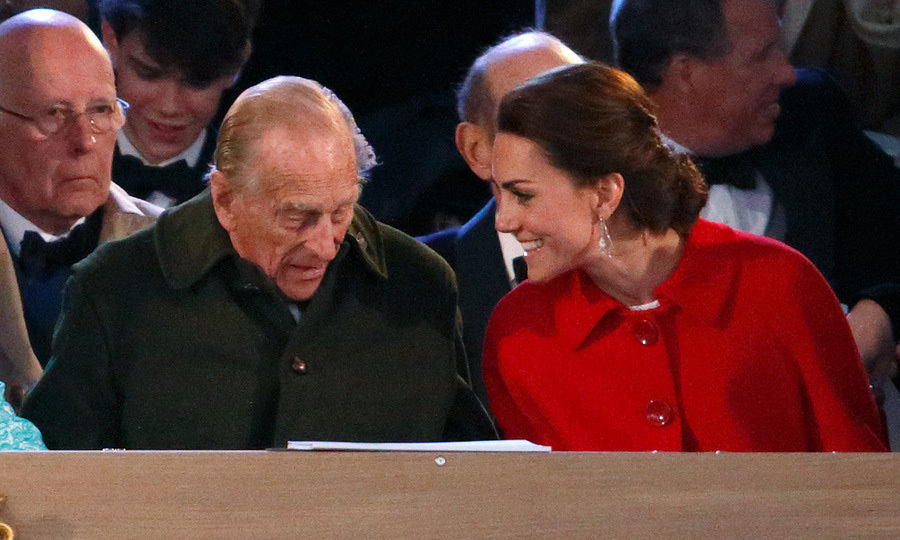 The Duchess of Cambridge's outfit was also a bit of a sartorial choice for the evening as she sore a red Zara jacket and white lace Dolce & Gabbana dress sitting next to Prince Philip for the performance.