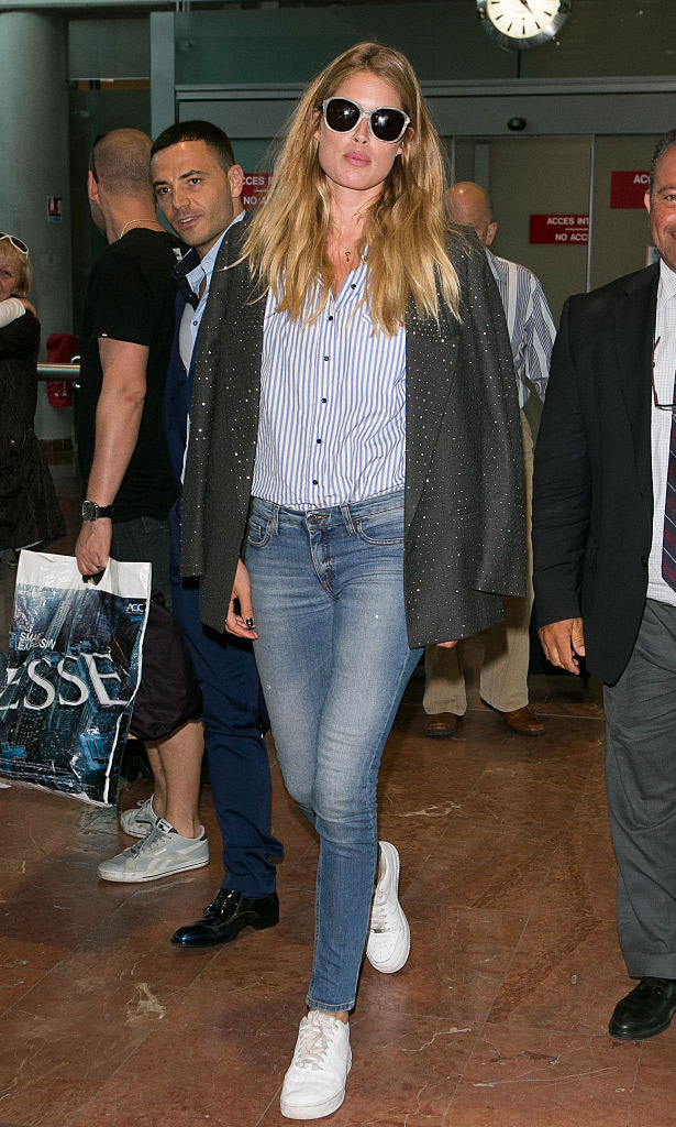 May 16: Model Doutzen Kroes was effortlessly stylish in sneakers, blue jeans, a striped button down and jacket draped over her shoulders as she arrived in France.