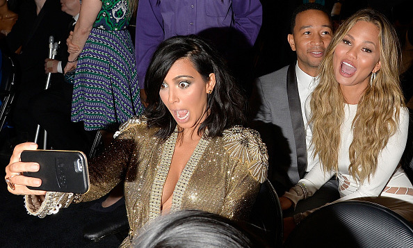 Ah, it's the Legends! Selfie queen Kim Kardashian included pals John Legend and Chrissy Teigen in her photo during the 57th Annual GRAMMY Awards.