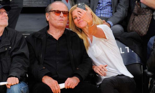 Courtside camera shots. Jack Nicholson took a moment to pose – pout and all! – with a fan during a Los Angeles Lakers game.