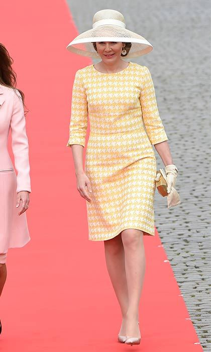 Nude accessories complement Queen Mathilde of Belgium's pretty print.